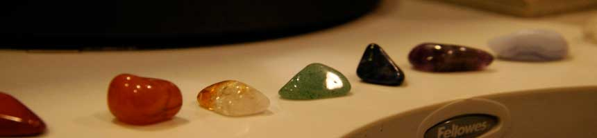 Gemstones displayed in order of chakra. Understanding the relationship of the chakras and their colors can help you select the proper gemstone or crystal to help you create your reality.