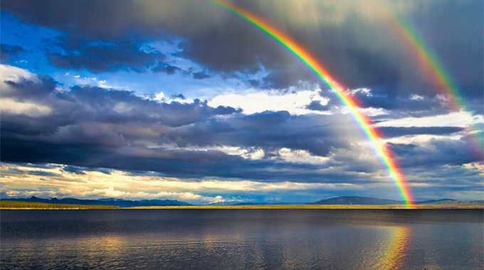 Rainbow Over Yellowstone Lake by David Grimes